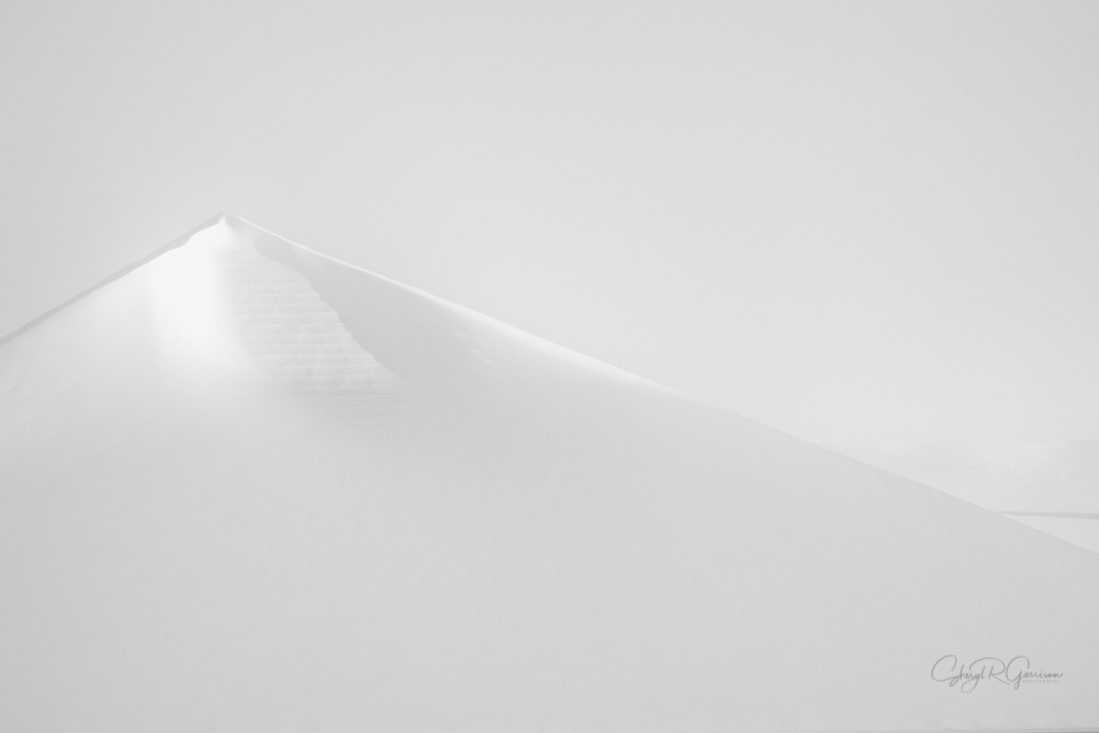 snow covered peak is on a roofline
